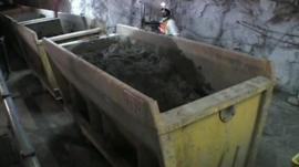 Big skips inside a mine containing earth.