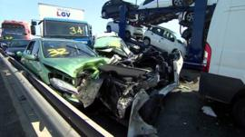 Damaged cars on the A249 after the crash