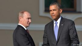 Russian President Vladimir Putin and US president Barack Obama shake hands