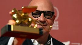 Italian director Gianfranco Rosi poses with the Golden Lion for Best Film for his movie