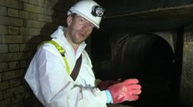 Tom Bateman in sewage tunnel
