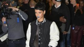 Rihanna poses at the launch of her new fashion collection in London