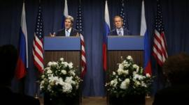 US Secretary of State John Kerry speaks next to Russian Foreign Minister Sergey Lavrov, (right)