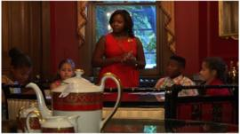Children at a table during an etiquette class in Washington