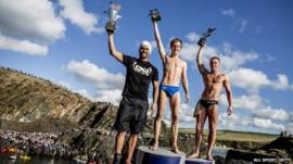 (L-R) Third placed Orlando Duque of Colombia, winner Gary Hunt of the UK and second place Artem Silchenko (R) of Russia celebrate on the podium at the Blue Lagoon during the sixth stop of the Red Bull Cliff Diving World Series