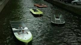 Solar boats parading on Amsterdam's canals