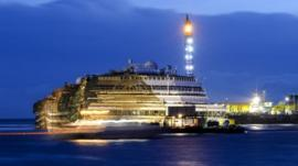 The wreck of Italy's Costa Concordia cruise ship emerges from water