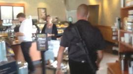 Man carrying rifle into Starbucks in the US