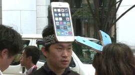 A man with an iPhone on his forehead