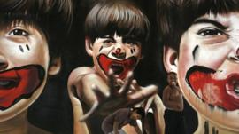 Boys plays in front of a painting by Brazilian artist Zack that is part of the ArtRua street art exhibition in Rio de Janeiro, Brazil