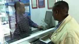 Man at money transfer counter