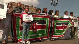 Nairobi's Asian Muslim community join hands for a human chain around the Westgate mall