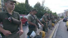 Police lines outside Athens court where neo-Nazi Golden Dawn members appeared