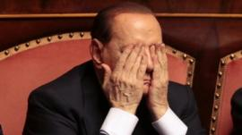 Italian center-right leader Silvio Berlusconi gestures during a confidence vote at the Senate in Rome, October 2, 2013.