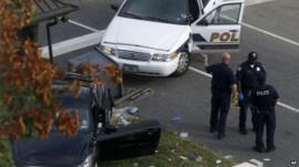 Crashed car and police car