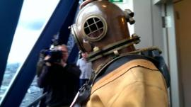 Lloyd Scott at the top of the 'Gherkin' in his 1940s diving suit