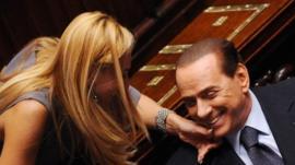 Italian MP Michaela Biancofiore (L) squeezes Italian Prime Minister Silvio Berlusconi
