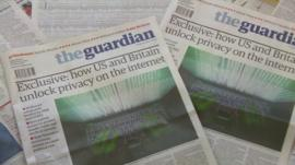 Copies of The Guardian newspaper.