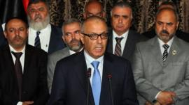 Libyan PM Ali Zeidan (centre) addresses the nation