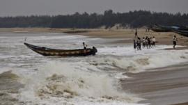 Fishermen prepare for the cyclone
