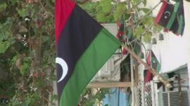 Flags hang on a building in Libya