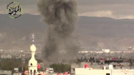 Smoke seen rising from buildings in Damascus