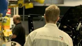 Staff in Peugeot factory