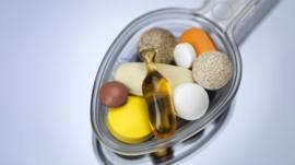 A spoon full of vitamin supplements