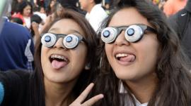 Children wearing googly eye glasses