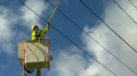 An engineer working on damaged power lines