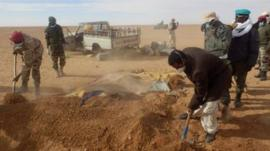 A grave being dug for one of the dead migrants