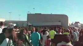 Passengers leave Los Angeles airport