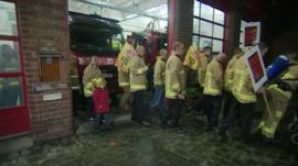 Fire fighters leave their York station