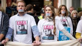Demonstrators take part in a silent protest outside the Russian embassy in west London on November 2, 2013, in support of Kieron Bryan, a journalist currently being held in a Russian prison