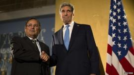 US Secretary of State John Kerry shakes hands with Egypt