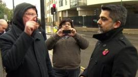 A protester confronts Brent Council's leader
