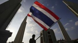 Anti-government protester waves flag in Bangkok