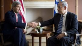 U.S. Secretary of State John Kerry (L) shakes hands with Israel's Prime Minister Benjamin Netanyahu in Jerusalem