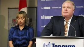 Toronto Mayor Rob Ford speaks at a news conference with his wife Renata at City Hall in Toronto, on 14 November 2013