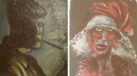 A combination of two formerly unknown paintings by German artist Otto Dix are beamed to a wall November 5, 2013, in an Augsburg courtroom during a news conference