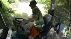 Worker resurfacing road