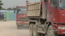 Trucks transporting building supplies in China