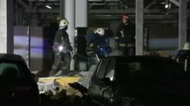 Emergency services at Riga roof collapse