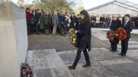Tatiana Schlossberg lays a wreath at the memorial