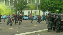 Brazilian police training in a simulation of a violent protest