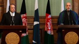 Afghan president Hamid Karzai (R) speaks during a joint press conference with Pakistani Prime Minister Nawaz Sharif