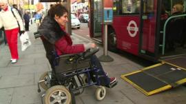 Fatemah Hossenpoor boarding a bus in a wheelchair