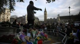 Floral tributes at Nelson Mandela statue in Parliament Square