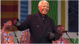 Nelson Mandela on stage with Ladysmith Black Mambazo