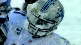 Detroit Lions' Calvin Johnson gets a face full of snow
